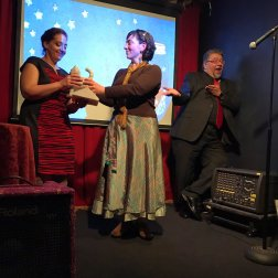 Molly MacArthur accepts the Here Kitty Kitty Prize on behalf of Luce Grosjean & Ron Koertge